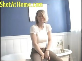 blond mama is posing and rubbing her pussy on