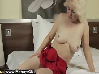 older blonde housewife stripping