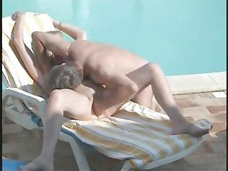 hidden cam. daddy fingering mommy on poolside