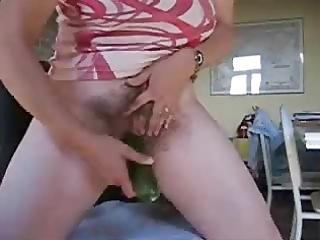 shaggy granny using large cucumber to masturbate