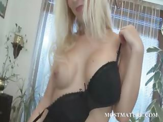 nice-looking hot mother i finger teases her muff