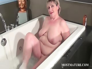 blond aged dildoing her pussy
