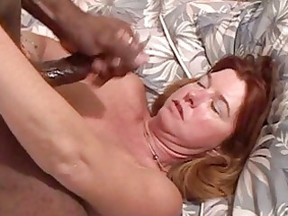 white redhead milf with large hooters sucks