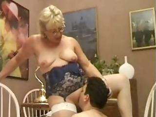 chunky mature blond coach eats his youthful knob
