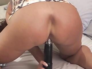 mature doxy playing with her juicy cookie on her