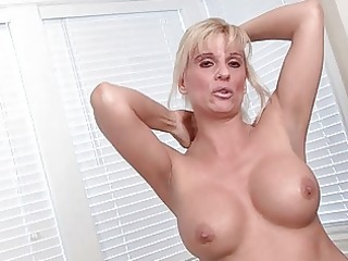 chic golden-haired milf undresses and pokes her