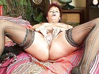 aged non-professional mommy squeezing her pussy