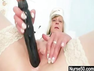 naughty aged golden-haired nurse rubs her muff