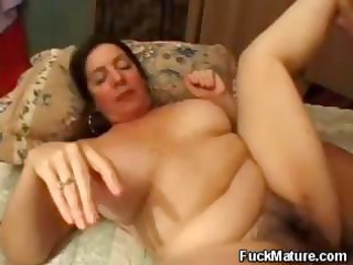 Plumper, mature brunette gets her hairy pussy