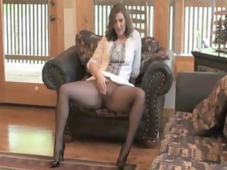 brunette hair d like to fuck sits on her chair in