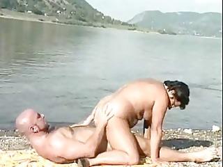 mature fucking on a beach