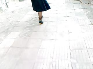 mature chick walking in dark heels