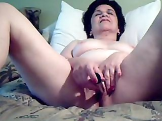 Mature plump lady is putting on a show by playing