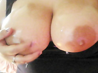 milf oiling up her large titts.