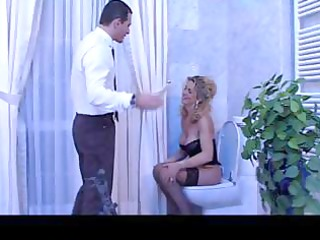 Busty blonde mature Italian babe blows his rod