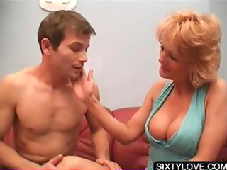older chick getting cunillingus on sofa