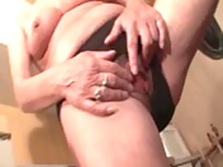 older whore in leather boots finger fucking