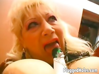 breasty milf rides a bottle like mad