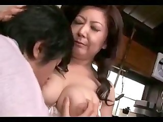 busty older woman getting her teats sucked the