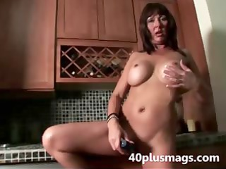 aged whore teasing with toy