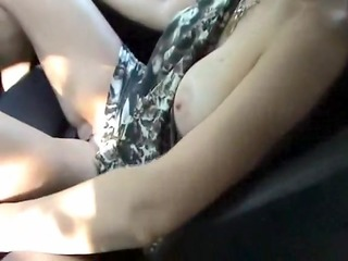 Wife touches herself in the car
