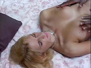 white blond babe on her knees with giant dark rod
