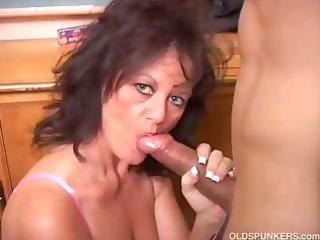 pretty mature babe gives a blowjob lesson