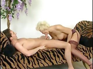 older blond whore teases his unbending dick and