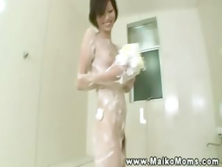 shy sexy asian mother i soaping herself up in the