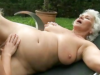 busty grandma and young hotty have sex outdoor