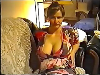 wife flashing large milk cans in a brassiere