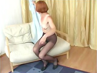 redhead granny in hose reaches in to rub her