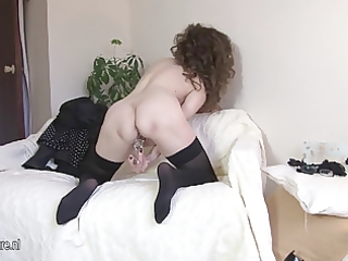 sexy 63yo mother fingering on the bed