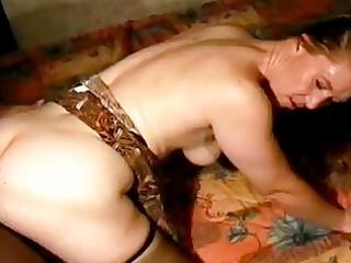 older enjoys a darksome rod in her ass