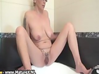 tattooed older housewife playing