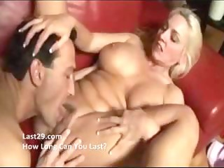 older blond with large melons gives a titjob and